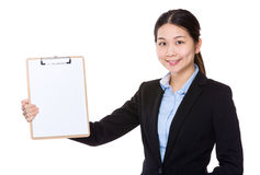 Businesswoman show with clipboard Stock Photography