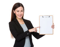 Businesswoman show with clipboard Stock Photo