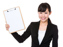 Businesswoman show with clipboard Stock Images