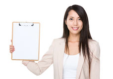 Businesswoman show with clipboard Royalty Free Stock Photos