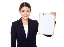 Businesswoman show with clipboard. Isolated on white background Royalty Free Stock Images