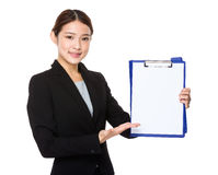 Businesswoman show with clipboard Stock Image