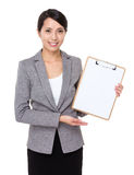 Businesswoman show with clipboard. Isolated on white background Stock Photo