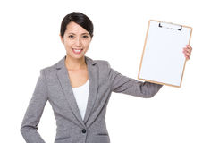 Businesswoman show with clipboard with white paper Royalty Free Stock Images