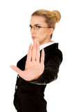 Businesswoman show NO gesture with confident expression Stock Photos