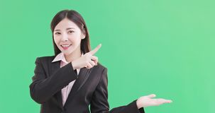 Businesswoman show something. To you on the green background Royalty Free Stock Photos