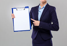 Businesswoman show with white paper of clipboard Stock Photography