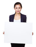 Businesswoman show with white poster Stock Images