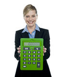 Businesswoman showing big green calculator Royalty Free Stock Image