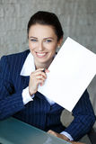 Businesswoman showing black white document Royalty Free Stock Image