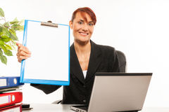 Businesswoman showing a blank clipboard stands Royalty Free Stock Photos