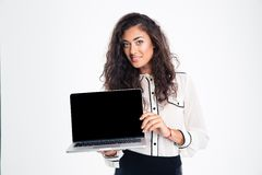Businesswoman showing blank laptop computer screen. Portrait of a smiling businesswoman showing blank laptop computer screen isolated on a white background Stock Images