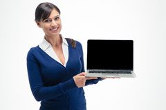Businesswoman showing blank laptop computer screen. Smiling businesswoman showing blank laptop computer screen isolated on a white background Stock Image