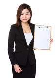Businesswoman showing with blank page of clipboard. Isolated on white background Stock Photos