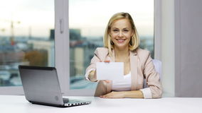 Businesswoman showing blank paper card at office stock video