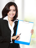 Businesswoman showing blank paper Royalty Free Stock Image