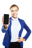 Businesswoman showing a blank smartphone screen Royalty Free Stock Images