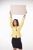 Businesswoman showing board or banner with copy Royalty Free Stock Images