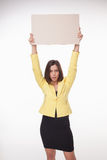 Businesswoman showing board or banner with copy Royalty Free Stock Photos