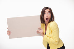 Businesswoman showing board or banner with copy Stock Photos