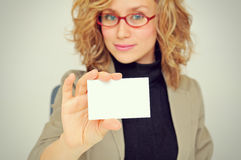 Businesswoman is Showing Business Card. Blonde Businesswoman is Showing Business Card stock photo