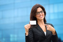 Businesswoman showing business card outside stock images