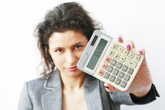 Businesswoman showing a calculator Stock Photo