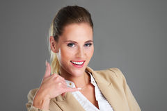 Businesswoman showing a call sign royalty free stock photo