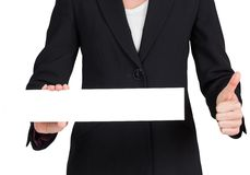 Businesswoman showing card and giving thumbs up Stock Image