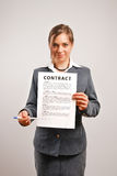 Businesswoman showing contract. Business woman holding a printed contract Royalty Free Stock Photo