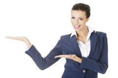 Businesswoman showing copy space on her palm Royalty Free Stock Photography