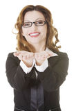 Businesswoman showing copy space on her palm Stock Photography