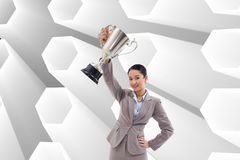 Businesswoman showing a cup Stock Photography