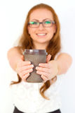 Businesswoman showing a cup of coffee Stock Images