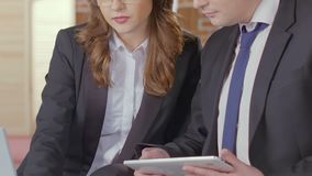 Businesswoman showing data on laptop to potential client, services presentation. Stock footage stock footage