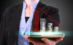Businesswoman showing decreasing business Stock Image