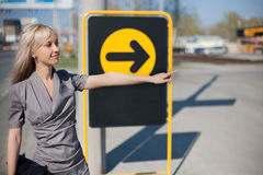 Businesswoman showing a direction of move Royalty Free Stock Image