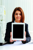 Businesswoman showing display of a tablet computer Stock Photo