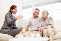 Businesswoman showing documents to senior couple Royalty Free Stock Photo