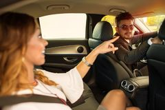 Businesswoman showing driver directions stock image