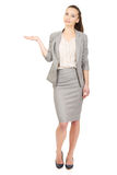 Businesswoman showing empty hand. Stock Photography