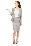 Businesswoman showing empty hand. Royalty Free Stock Photography