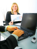 Businesswoman Showing Financial Chart Stock Photo