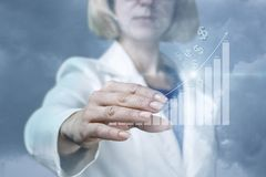 Businesswoman showing a graph of financial growth Stock Photography