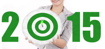 Businesswoman showing a green dartboard Royalty Free Stock Images