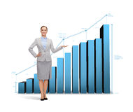 Businesswoman showing growing chart Royalty Free Stock Images