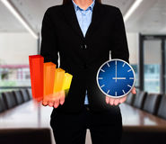Businesswoman showing Growth graph and clock. Success Work. Time - Stock Image Royalty Free Stock Photography