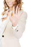Businesswoman showing hand to camera. Royalty Free Stock Photography