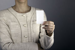 Businesswoman showing and handing a blank business card Stock Photo