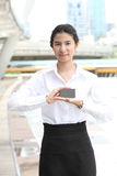 Businesswoman showing and handing a blank business card - clippi Stock Image